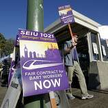 A picket line forms in front of the BART Lake Merritt station in Oakland, Calif. on Friday Oct. 18, 2012. After contract talks broke down between BART management and the unions, workers went on strike at 12 am Friday morning and  BART service has come to a stop system wide.