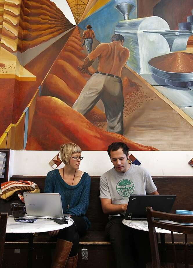 Tabi Musselwhite and Nate Singer avoid the morning commute and work at Spasso Coffee House in Oakland, Calif. on Friday Oct. 18, 2012. After contract talks broke down between BART management and unions, workers went on strike at 12 am Friday morning and BART service has come to a stop system wide. Photo: Michael Macor, The Chronicle