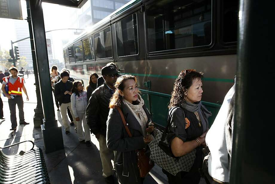 Passengers line up on 20th St. to board a Transbay AC Transit buss heading to San Francisco from downtown Oakland, CA Friday, October 18, 2013. Bay Area Transit workers went on strike shutting down train service after BART management and union leaders with Bay the Amalgamated Transit Union Local 1555 and the SEIU Local 1021failed to reach a contract agreement. Photo: Michael Short, The Chronicle