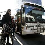 Reah DeCaro of Oakland waits to put her bike on a Transbay AC Transit buss as she heads to San Francisco from downtown Oakland, CA Friday, October 18, 2013.Bay Area Transit workers went on strike shutting down train service after BART management and union leaders with Bay the Amalgamated Transit Union Local 1555 and the SEIU Local 1021failed to reach a contract agreement.
