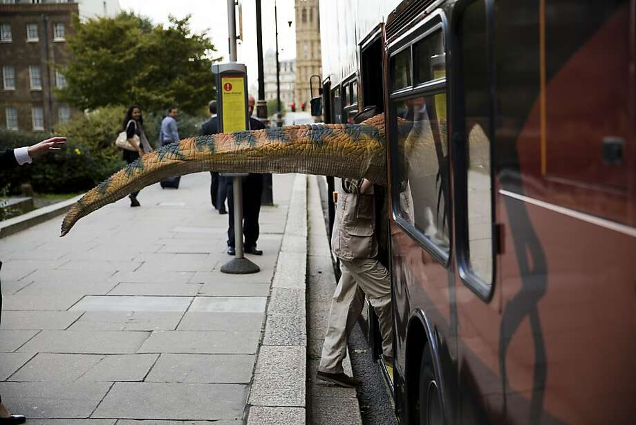 I guess we'll wait for the next bus: Promoters of the Dinosaur Experience exhibit at Blackgang Chine theme park on the Isle of White rely on the London transit system like anyone else. Photo: Matt Dunham, Associated Press