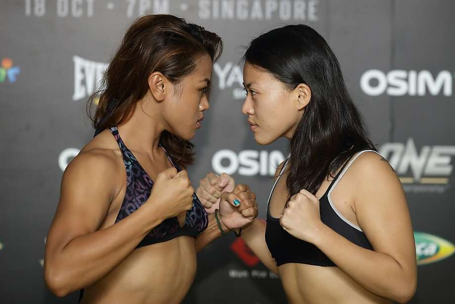 You and what army? Ann Osman of Malaysia and Sherilyn Lim of Singapore look ready to mix it up during the official weigh-in for their One Fighting Championship bout at Chijmes in Singapore. Photo: Suhaimi Abdullah, Getty Images