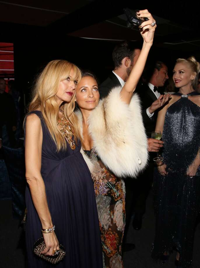Rachel Zoe, left, and Nicole Richie take a photo at the Wallis Annenberg Center for the Performing Arts Inaugural Gala on Thursday, Oct. 17, 2013, in Beverly Hills, Calif. Seen at right is musician Gwen Stefani. (Photo by Brian Dowling/Invision/AP) Photo: Associated Press