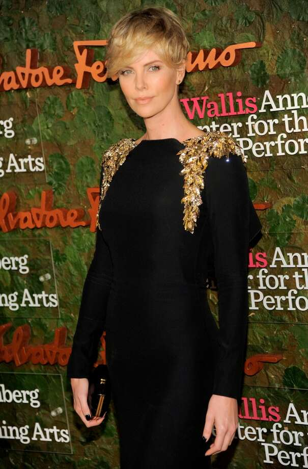 Actress Charlize Theron arrives at the Wallis Annenberg Center for the Performing Arts Inaugural Gala on Thursday, Oct. 17, 2013, in Beverly Hills, Calif. (Photo by Chris Pizzello/Invision/AP) Photo: Associated Press