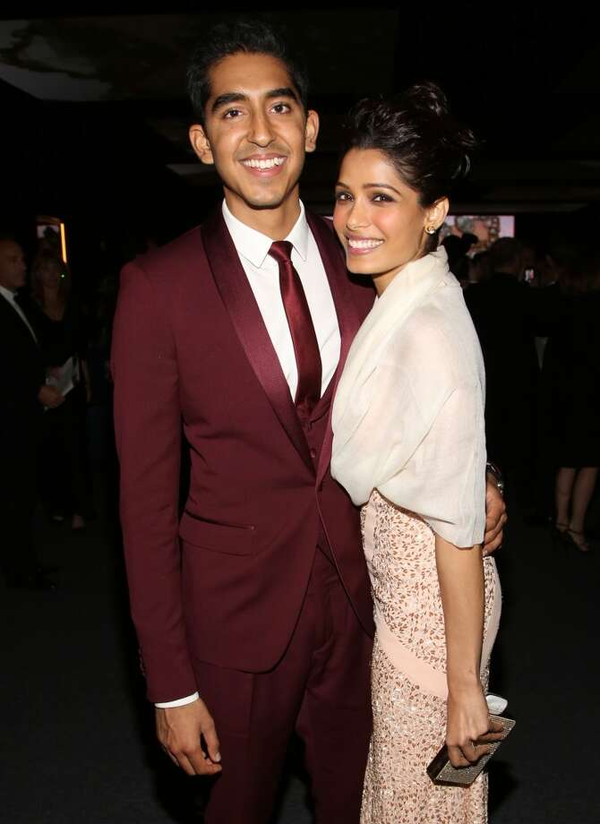 Actors Dev Patel, left, and Freida Pinto attend the Wallis Annenberg Center for the Performing Arts Inaugural Gala on Thursday, Oct. 17, 2013, in Beverly Hills, Calif. (Photo by Brian Dowling/Invision/AP) Photo: Associated Press