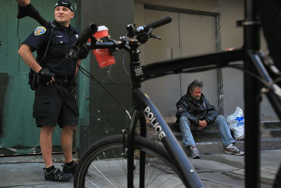 Problem behavior such as heavily intoxicated people on the streets can be dealt with by San Francisco police. In this 2013 case, the suspect was taken to a detox center. Photo: Leah Millis, The Chronicle