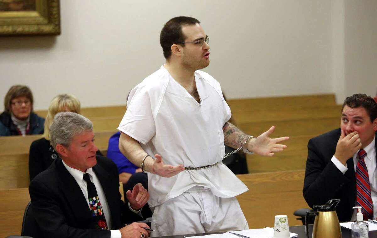 During a courtroom outburst, Michael Chadd Boysen stands up and swears at a relative during his sentencing hearing. Boysen if flanked by his attorneys, James Conroy, left, and Scott Ketterling. Boysen was given two life sentences without the possibility of parole for killing his grandparents after they welcomed him home from prison in March 2013. Photographed on Friday, October 18, 2013 at the King County Courthouse.