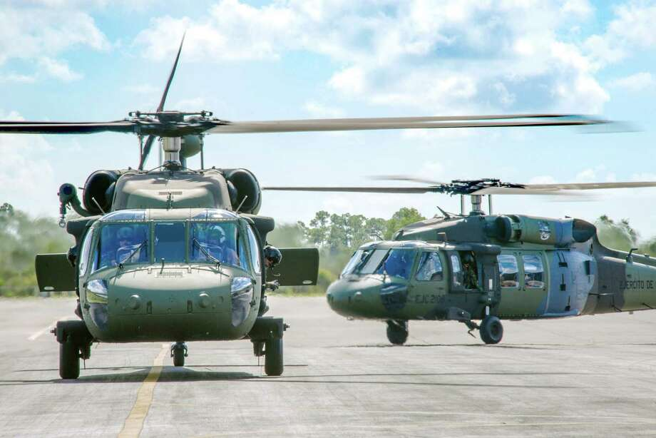 The Colombian Army flew two S-70i BLACK HAWK helicopters to Colombia following acceptance from Sikorsky's West Palm Beach, Fla., facility in late August. The new aircraft come equipped with a Terrain Awareness and Warning System as standard equipment to alert the pilots to obstacles.  (PRNewsFoto/Sikorsky Aircraft) Photo: Contributed Photo / Connecticut Post Contributed
