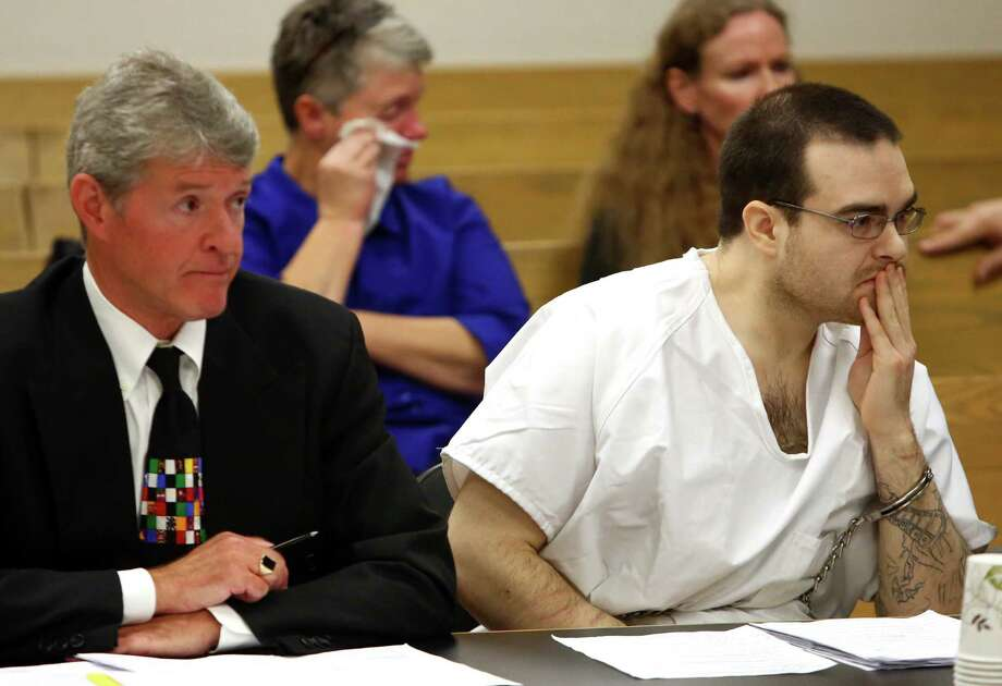 Michael Chadd Boysen, right, listens as him mom Melanie Taylor addresses the court during his sentencing hearing. At left is his attorney James Conroy. Boysen was given two life sentences without the possibility of parole for killing his grandparents after they welcomed him home from prison. Photographed on Friday, October 18, 2013 at the King County Courthouse. Photo: JOSHUA TRUJILLO, SEATTLEPI.COM / SEATTLEPI.COM