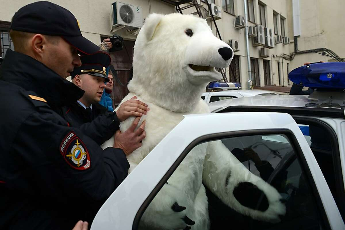 You fools, I'm plainclothes. Wait until Putin finds out: Moscow police haul away an anti-Greenpeace