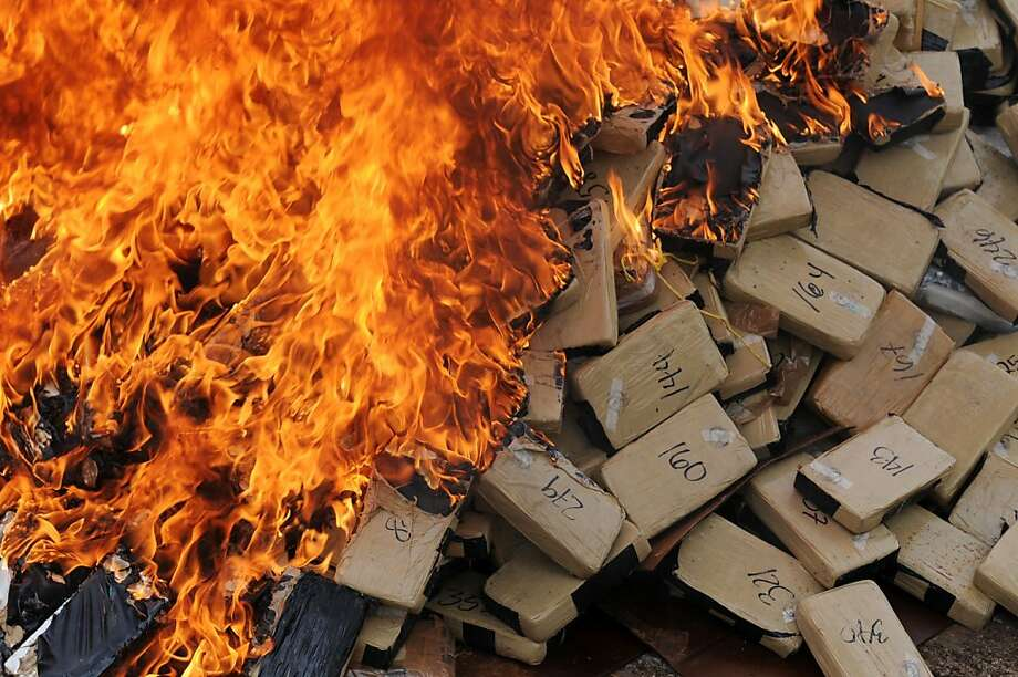 Burned so it will never be snorted: Prosecutors incinerate some 420 kilos of cocaine seized in La Mosquitia, Honduras. Honduras has become a major transit point for U.S.-bound drugs from South America and has the highest murder rate in the world - 85.5 homicides per 100,000 inhabitants annually. Photo: Orlando Sierra, AFP/Getty Images