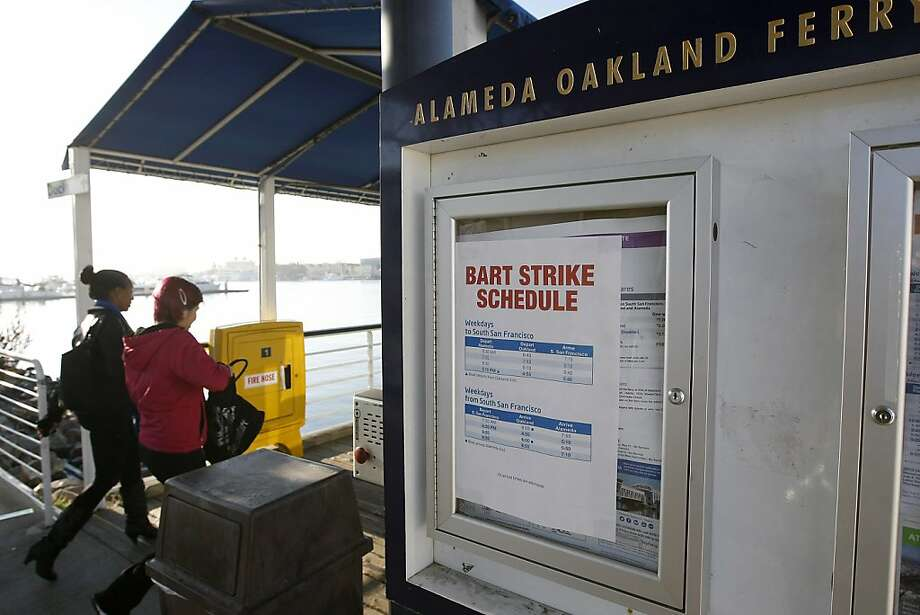 A BART Strike Schedule is seen posted as passengers head towards a San Francisco bound ferry at the Jack London Square Ferry Terminal in Oakland, CA Friday, October 18, 2013. Bay Area Transit workers went on strike shutting down train service after BART management and union leaders with Bay the Amalgamated Transit Union Local 1555 and the SEIU Local 1021failed to reach a contract agreement. Photo: Michael Short, The Chronicle