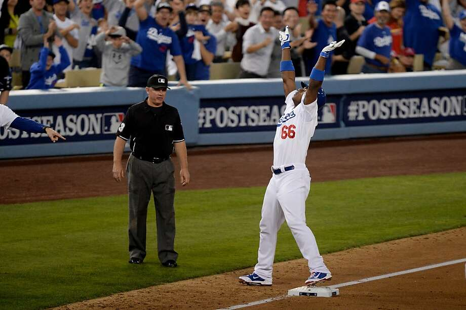 Yasiel Puig exults after his RBI triple in Game 3 of the NLCS - an act that fired up the L.A. crowd and irked the Cardinals. Photo: Harry How, Getty Images