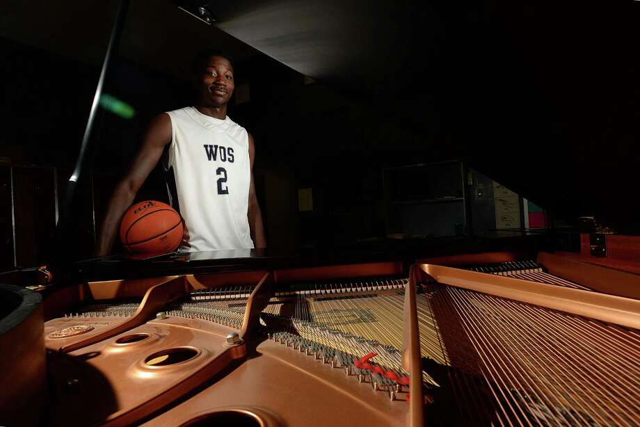 As talented on the court as he is the keys, West Orange-Stark's point guard Laquarious Paige has been scouted by  Harvard and Rice. Laquarius says he does not read music, but can play the piano, guitar and other instruments by ear.  Photo taken Wednesday, October 16, 2013 Guiseppe Barranco/The Enterprise Photo: Guiseppe Barranco, Photo Editor