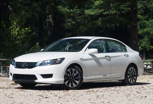 Model:   2014 Honda Accord Honda's popular Accord sedan aims to lead in the efficiency space with an array of efficient powerplant choices including four-cylinder, V-6, hybrid, and plug-in hybrid versions.   Source: Green Car Journal