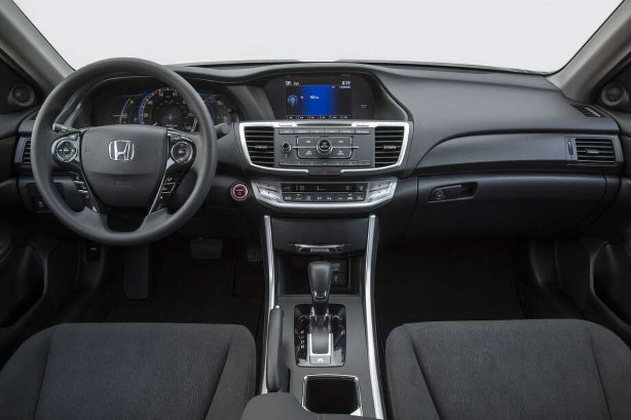 Model:  2014 Honda AccordEven the V-6, the largest engine option, nets 34 highway mpg with the four-cylinder rated at up to 36 highway mpg. The bar raises considerably with the Accord Hybrid at 50 city and 47 highway mpg, and the Accord Plug-In with its 47 city and 46 highway mpg on hybrid power. Source: Green Car Journal Photo: Autoblog.com