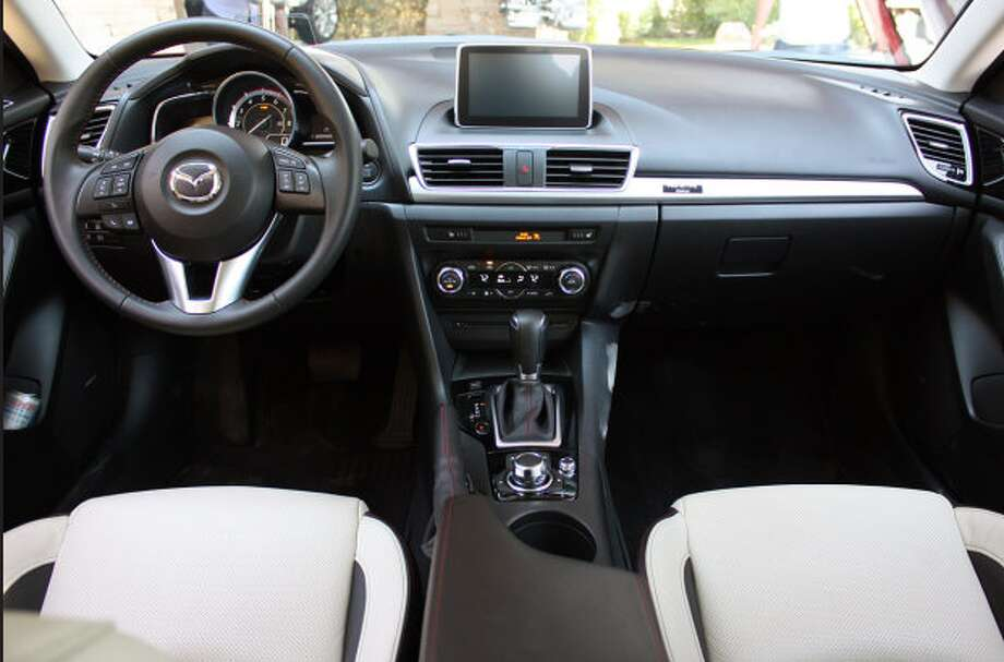 Model:  2014 Mazda3The 2.0-liter powered Mazda3 four-door sedan offers best-in-class 41 mpg highway fuel economy, with the five-door hatch coming in at up to 40 mpg.Source: Green Car Journal Photo: Autoblog.com