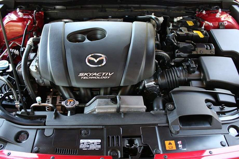 Model:  2014 Mazda3A more powerful 2.5-liter engine with an i-ELOOP capacitor-based regenerative engine braking system gets 38 mpg.Source: Green Car Journal Photo: Autoblog.com