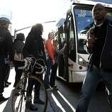Passengers board an AC Transit buss heading to San Francisco from 20th St. in downtown Oakland, CA Friday, October 18, 2013.Bay Area Transit workers went on strike shutting down train service after BART management and union leaders with Bay the Amalgamated Transit Union Local 1555 and the SEIU Local 1021failed to reach a contract agreement.