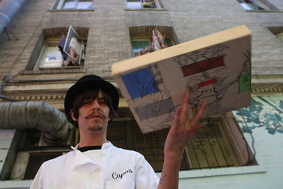 "Matt Molina holds his art for ""Pachyderms and Pancakes,"" the first event held by the artist collective Four Word Movement. Photo: Liz Hafalia, The Chronicle"