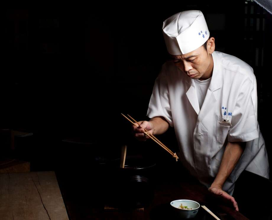 Japan: Kenji Nagata, a chef at Azabu Yukimura restaurant, prepares Takikomi Gohan, a rice dish seasoned and cooked with various ingredients, at the restaurant in Tokyo, Japan Photo: Ko Sasaki, Bloomberg