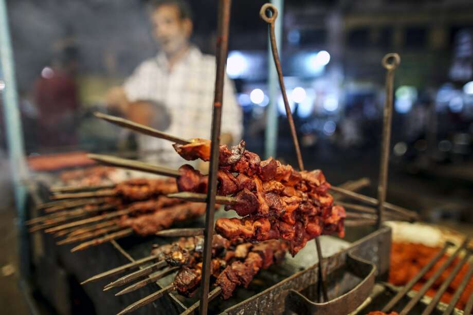 India: A vendor prepares street food in Bangalore, India. Photo: Dhiraj Singh, Bloomberg