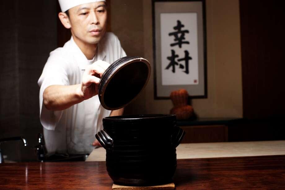 Japan: Kenji Nagata, a chef at Azabu Yukimura restaurant, prepares Takikomi Gohan, a rice dish seasoned and cooked with various ingredients, at the restaurant in Tokyo, Japan. Photo: Ko Sasaki, Bloomberg