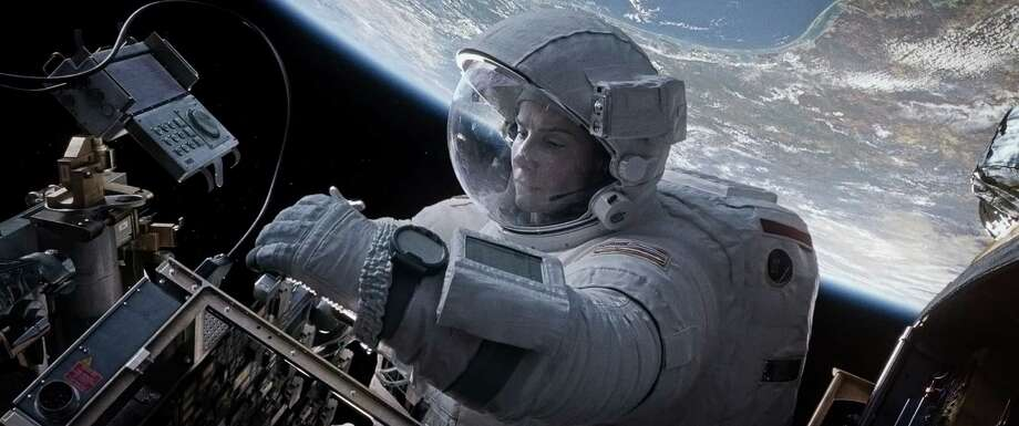 "Sandra Bullock stars as an astronaut sent tumbling into space in the thriller ""Gravity."" Photo: HOEP / Warner Bros. Pictures"