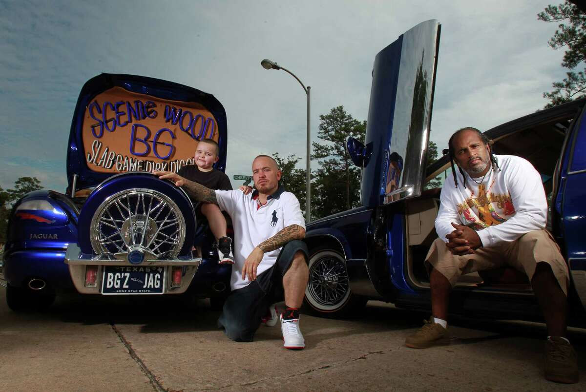 """Junior Porter, 5, from left, his father, B.G. Porter, and Timothy """"Toolman"""" Berard are part of the Blue Line car club."""