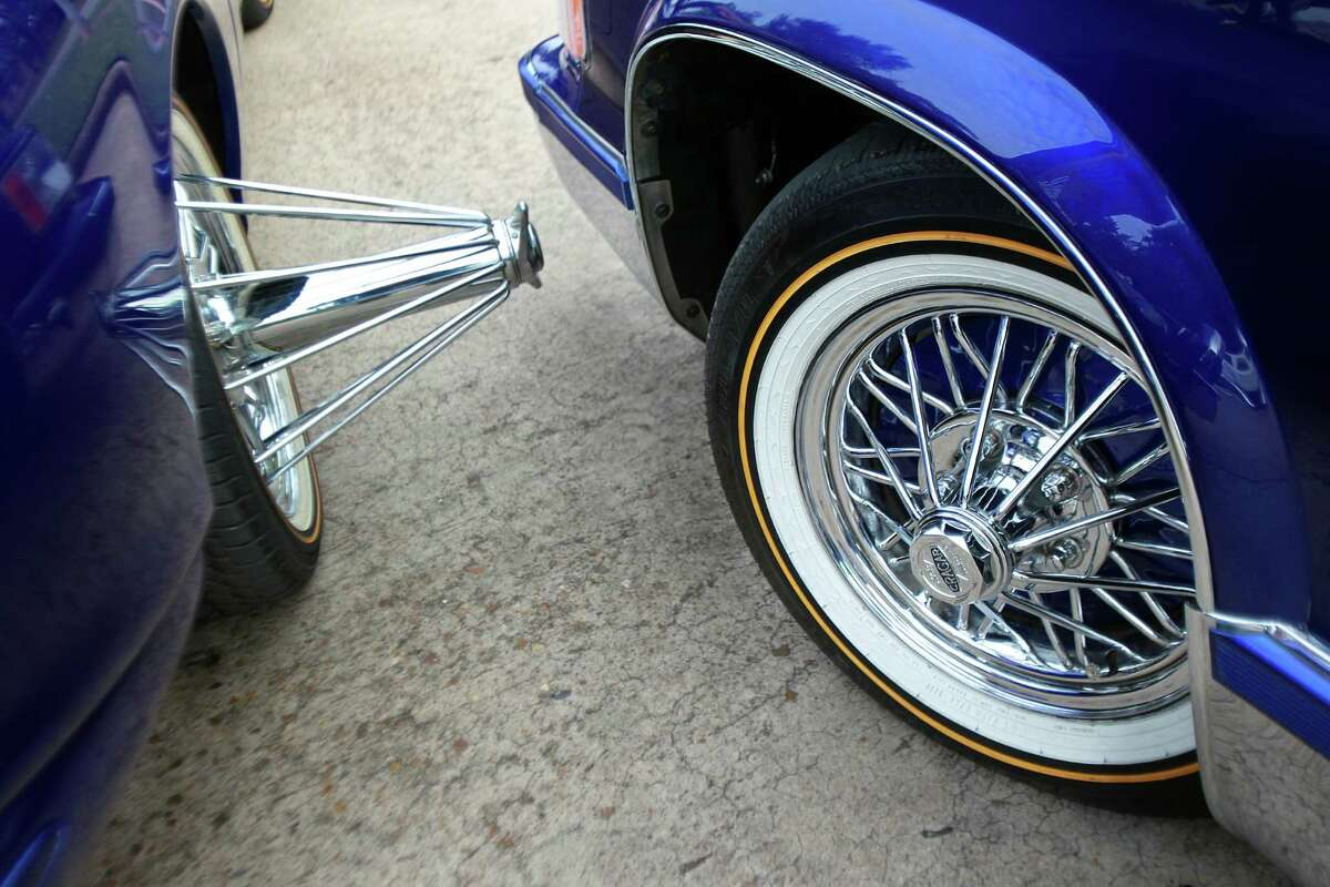 Rims and good tires can be found on the cars of B.G. Porter, who runs a customizing car shop.