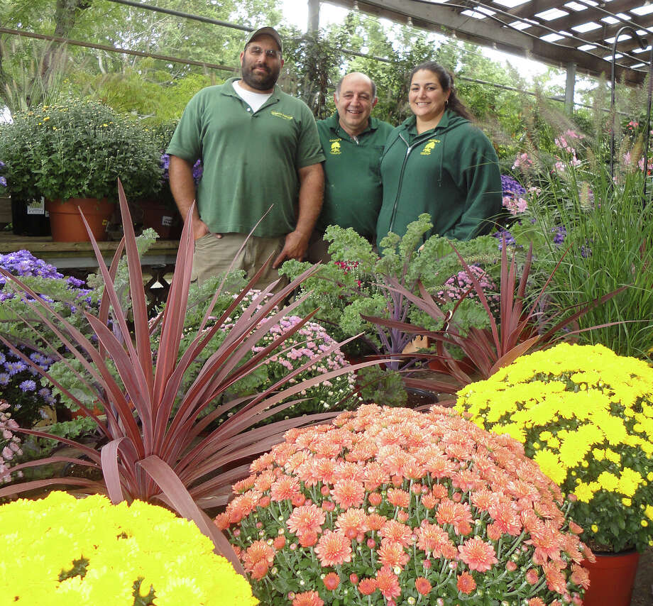 The Ganim's Garden Center and Florist family, from left, Austin, Lee and Merrilee Ganim pose at their business on Kings Highway Cutoff, marking its 75th anniversary this year. Photo: Meg Barone / Fairfield Citizen contributed