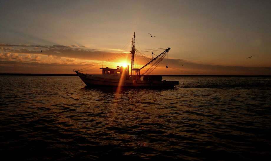 The sun rises over a shrimp boat near the Houston Ship Channel, Friday, Sept. 27, 2013, in Kemah. (Cody Duty / Houston Chronicle) Photo: Cody Duty, Staff / © 2013 Houston Chronicle