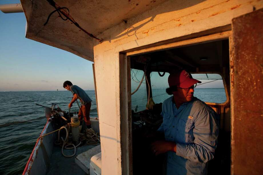 Interdisciplinary artists Eric Leshinsky, left, and Zach Moser have been researching the shrimping business the hard way, by operating their own commercial boat. Photo: Cody Duty, Staff / © 2013 Houston Chronicle