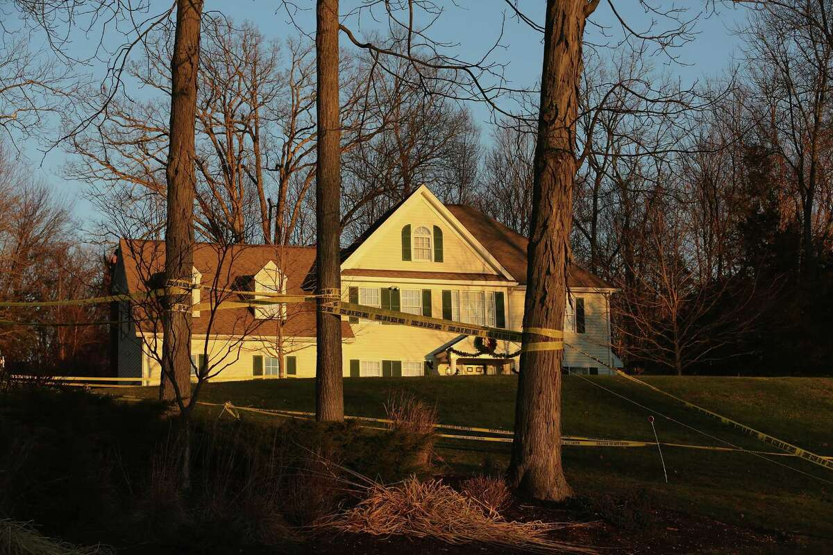 Police tape stretches across the front yard of the Lanza residence on December 19, 2012 in Newtown, Connecticut. Adam Lanza reportedly shot his mother Nancy Lanza last Friday before he killed 26 others, including 20 children, at Sandy Hook Elementary School.