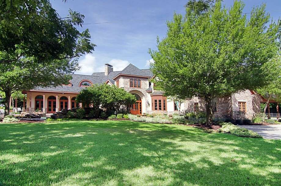 Built in 1997, this 6,821-square-foot home sits on Alkire Lake in Sugar Land.  Agent: Cindy Burns, Martha Turner Properties