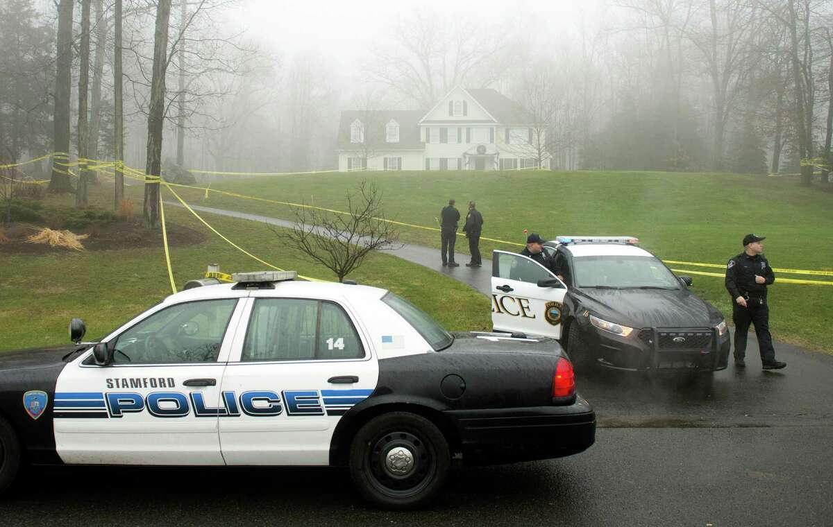 Police outside the home of Nancy Lanza December 18, 2012 in Newtown, Connecticut. Nancy Lanza was killed by her son Adam before going on his rampage at Sandy Hook Elementary School on December 14, 2012.