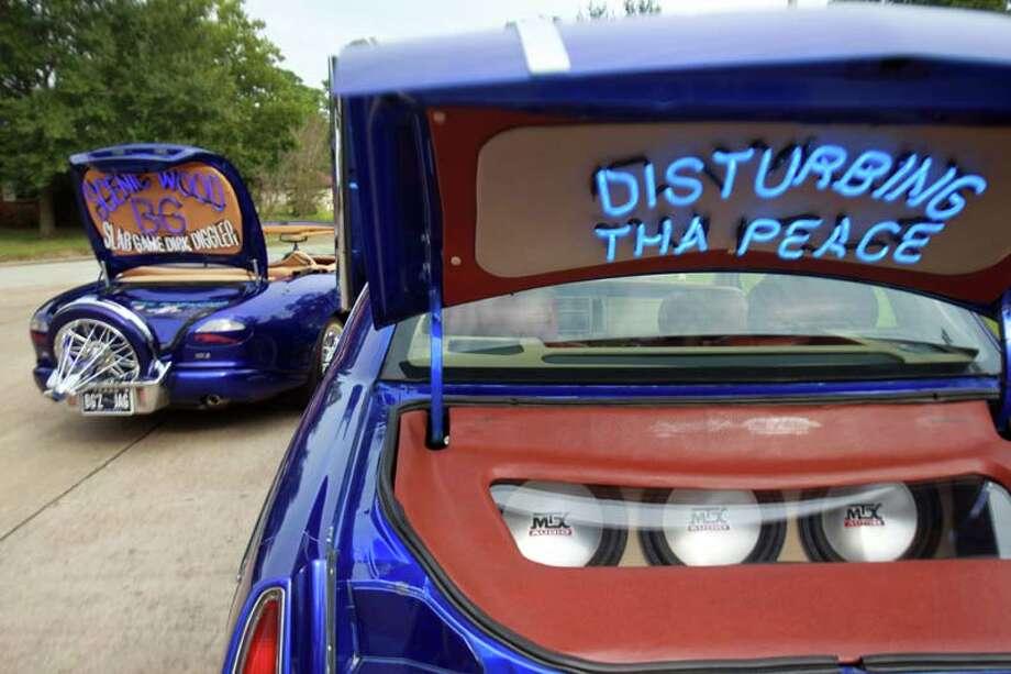 "Timothy ""Toolman"" Berard, who drives an old-school 1993 Cadillac, has blue neon lights in his trunk.  ( Mayra Beltran / Houston Chronicle ) Photo: Mayra Beltran, Houston Chronicle / © 2013 Houston Chronicle"