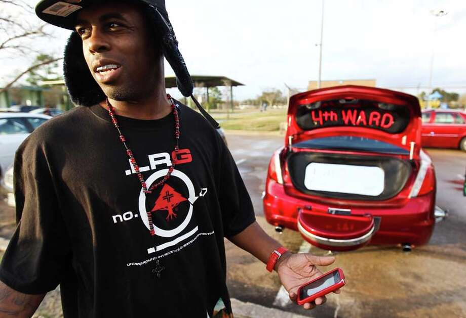 King Fish jokes with on lookers as he represents 4th Ward with his car, a five wheel slab painted red to represent his team in 2012 at Cloverland Park in Houston. Teams are made up of people from certain neighborhoods. King Fish says he buys and fixes up cars for people in his neighborhood. ( Nick de la Torre / Houston Chronicle ) Photo: Nick De La Torre, Houston Chronicle / © 2012  Houston Chronicle