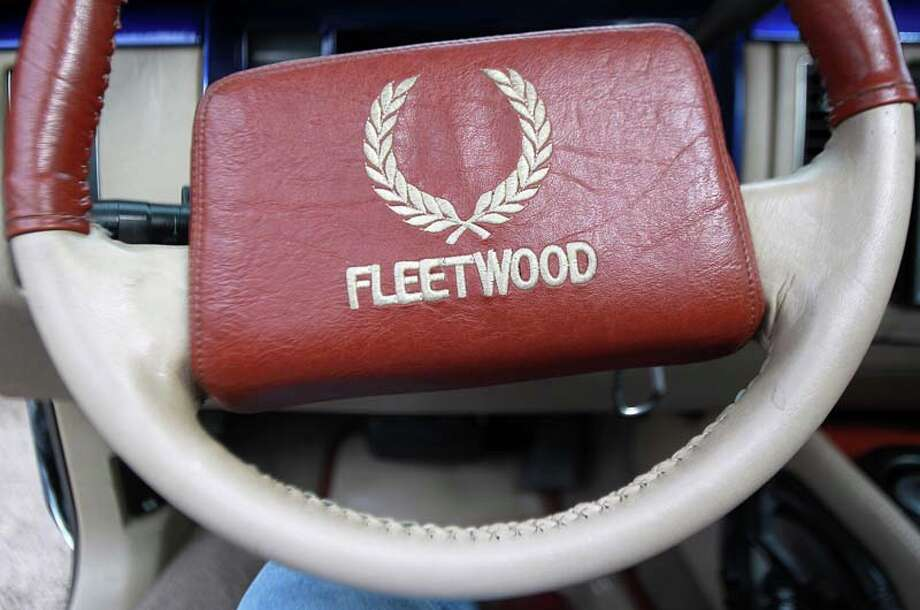 "Timothy ""Toolman"" Berard, who drives an old-school 1993 Fleetwood Cadillac and member of the Blue Line car club, has leather on the steering wheel.  ( Mayra Beltran / Houston Chronicle ) Photo: Mayra Beltran, Houston Chronicle / © 2013 Houston Chronicle"