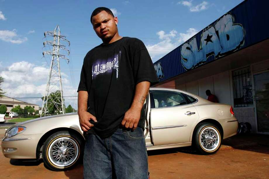 "Da SLAB Spot owner, Tony Price, stands in front of his shop next to a SLAB or a ""Slow, Loud and Bangin'"" vehicle in 2007. ( Johnny Hanson / For the Chronicle) Photo: Johnny Hanson, For The Chronicle / Freelance"