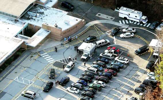 Responders gather at the scene of a mass school shooting at Sandy Hook Elementary School on December 14, 2012 in Newtown, Connecticut. Photo: Mario Tama, Mario Tama/Getty Images / 2012 Getty Images