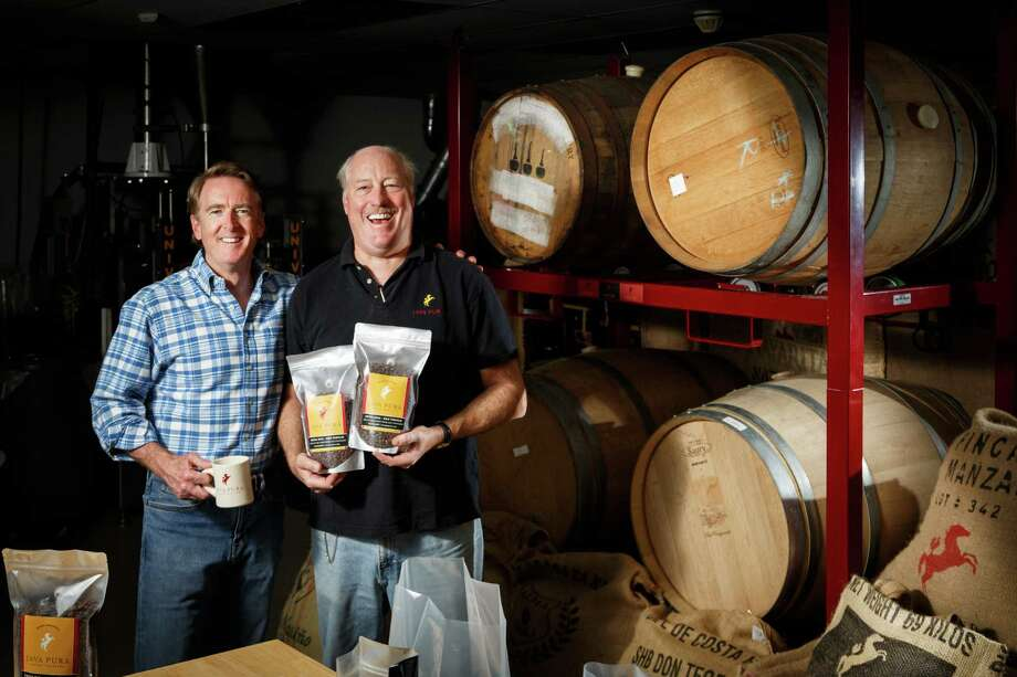 Java Pura coffee-roasting partners Richard Colt, left, and Fielding Cocke age their coffee beans in oak casks. Photo: Michael Paulsen, Staff / © 2013 Houston Chronicle