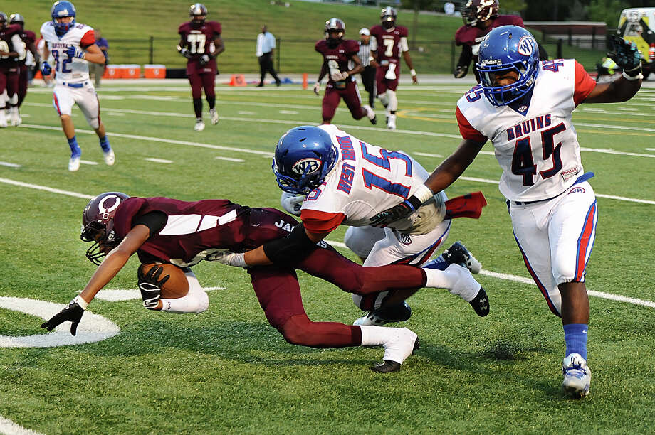 West Brook's Devin Padia (No. 15) and Dominique Siemein (No. 45) bring down Central's Carnell Seals (No. 5) during a game at Carroll Thomas Stadium earlier this year. Photo provided by Drew Loker. Photo: Drew Loker / 2013
