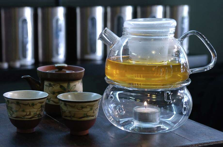 Hot Gin PunchThis drink can be served either in a punch bowl or a teapot. It is a good drink to serve for a large group. The great thing is if you are serving it at a party, the guests can serve themselves. All you have to do is put it out and enjoy a cup with everyone else.  Photo: Melissa Phillip, Staff Photographer / Houston Chronicle