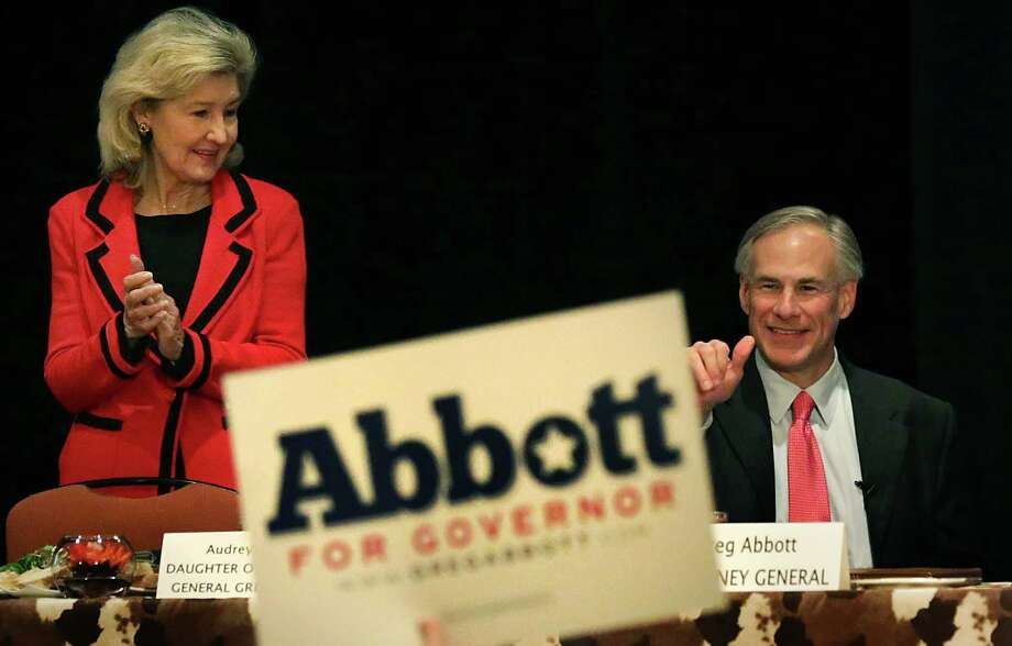 Texas Attorney General Greg Abbott, the Republican candidate for governor, speaks at the luncheon of Texas Federation of Republican Women at the Grand Hyatt, Friday, Oct. 18, 2013. U.S. Senator Kay Bailey Hutchison, left, applauds as he is introduced. Photo: BOB OWEN, San Antonio Express-News / © 2012 San Antonio Express-News