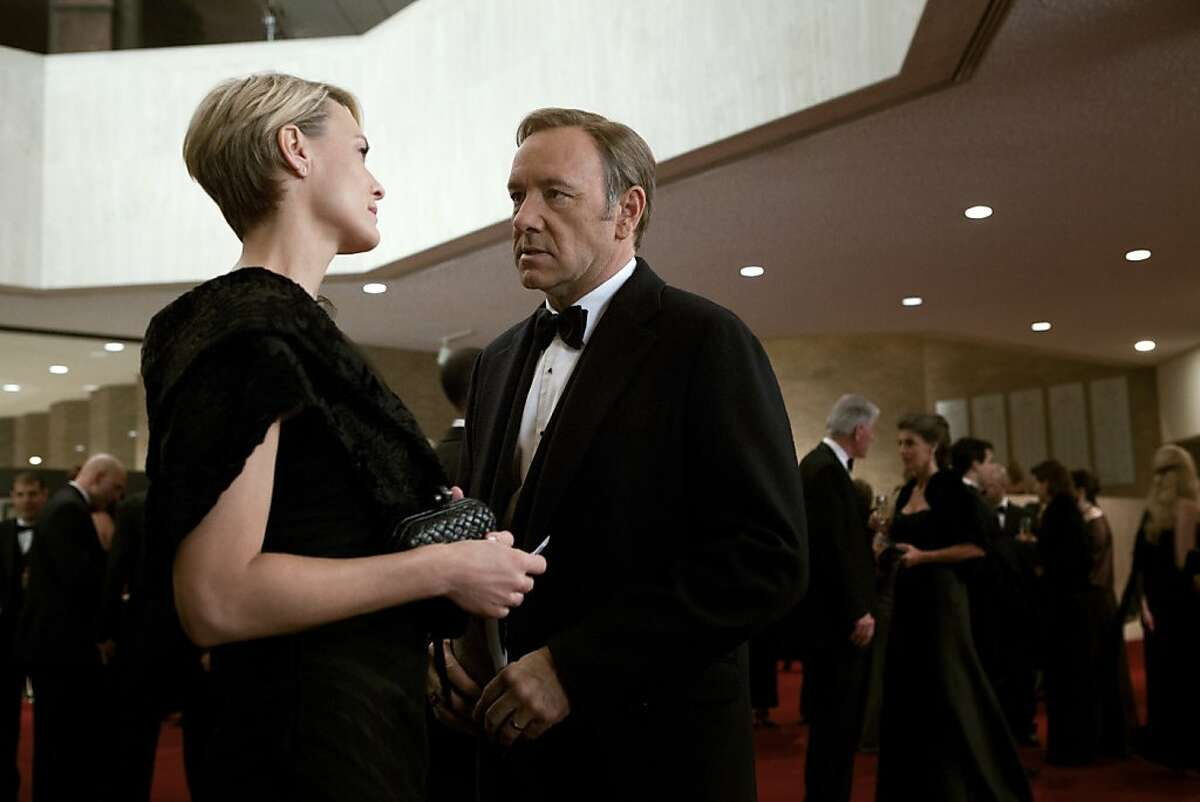 """In an undated handout photo, Robin Wright, left, and Kevin Spacey in Netflix's """"House of Cards."""" While no deals appear to be imminent, a few major cable providers are in discussions with Netflix about making it - and other online video services - available through the set-top-boxes that most Americans have in their living rooms. (Melinda Sue Gordon/Netflix via The New York Times) -- NO SALES; FOR EDITORIAL USE ONLY WITH STORY SLUGGED NETFLIX CABLE BY BRIAN STELTER. ALL OTHER USE PROHIBITED."""