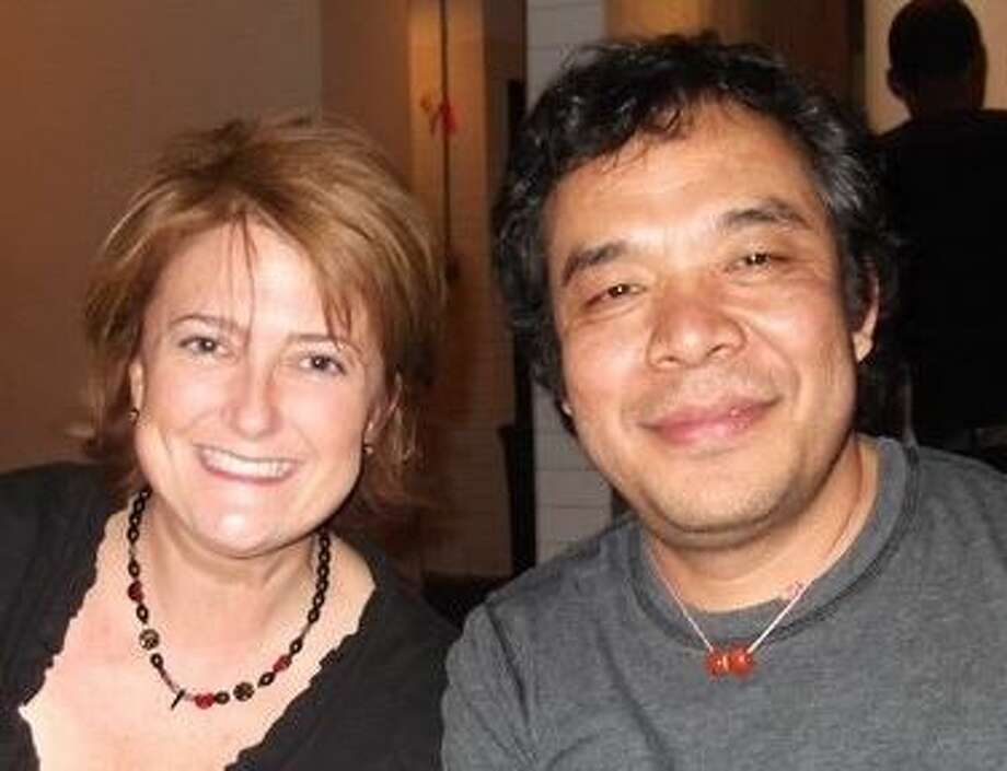Greenwich music teacher Roxanna Zampieri with her guest director/producer Ngawang Choephel at The Gingerman on October 17. Photo: Contributed Photo / Greenwich Time contributed