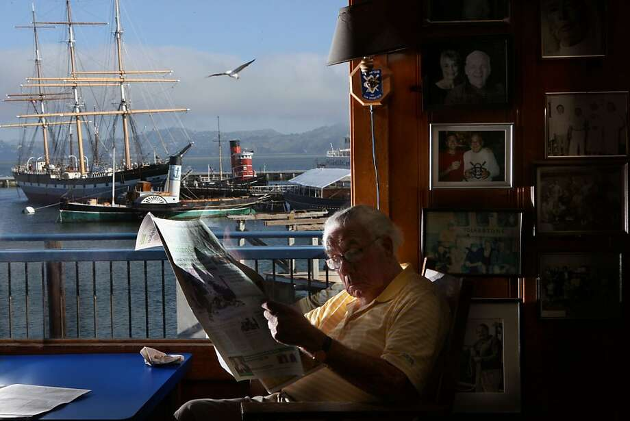 Lou Marcelli, caretaker of the Dolphin Club, reads The Chronicle before starting his daily routine at the club in 2011. Photo: Liz Hafalia, The Chronicle