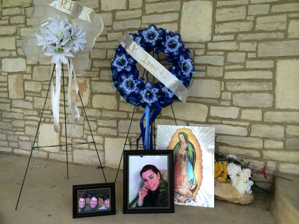 Neighbors and family members built a memorial to Irma Davila and her daughter, Destiny, on their front porch on Globe Avenue. The two were found dead at the home Thursday. Police believe Hector Davila -- Irma's estranged husband and Destiny's father -- killed them before fatally shooting himself.