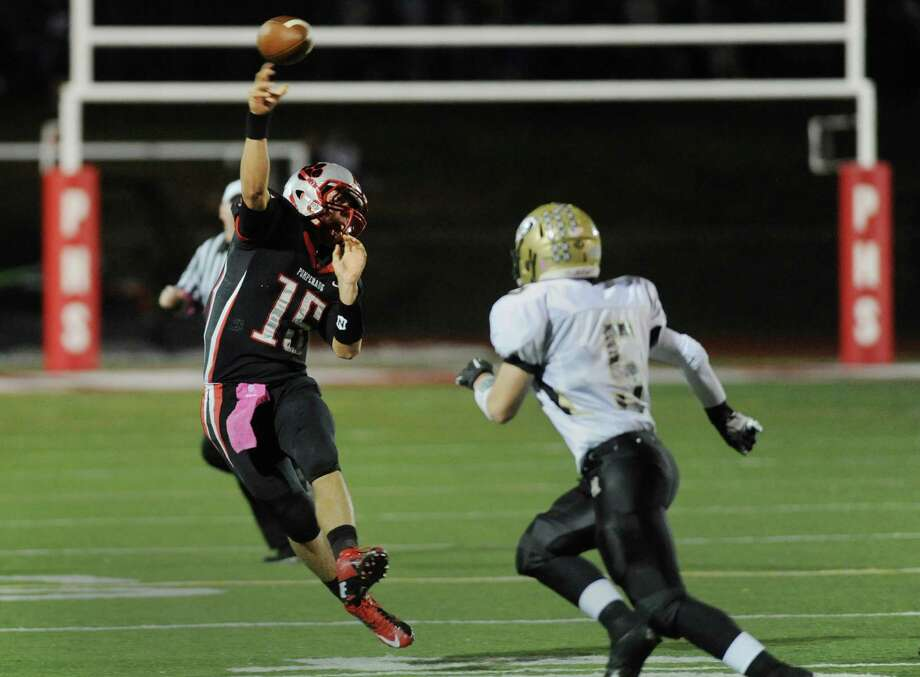 Pomperaug quarterback Wade Prajer throws a pass in the high school football game between Pomperaug and Woodland at Pomperaug High School in Southbury, Conn. on Friday, Oct. 18, 2013. Photo: Tyler Sizemore / The News-Times